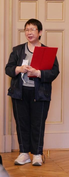 Yen Kuan, attachée de direction